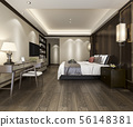 bedroom suite in hotel with tv and working table 56148381