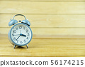 Close-up alarm clock on wooden table of brown 56174215