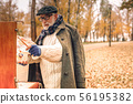 Senior man drawing a painting in park 56195382