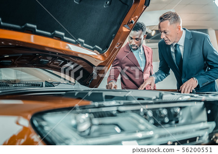 Two men exploring construction of the automobile.