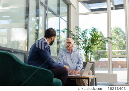 Cheerful grey-haired man consulting with progressive businessman 56218408