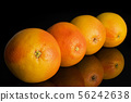 Fresh pink grapefruit isolated on black glass 56242638