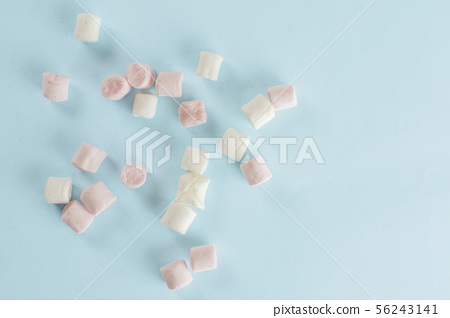 Sweet fluffy marshmallow isolated on light blue 56243141