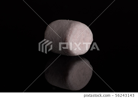 Sweet fluffy marshmallow isolated on black glass 56243143