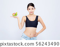 Beautiful portrait young asian woman hold salad 56243490