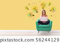 Idea light bulbs with woman using a laptop 56244129