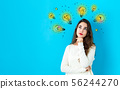 Idea light bulbs with young woman 56244270