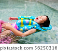 Happy cute girl in swimming pool 56250316