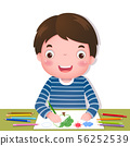 Cute boy drawing with colourful pencils 56252539