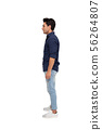 Side view of a young casual man standing isolated 56264807