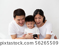 Cheerful young Asian family with son making selfie 56265509