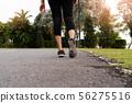 sport woman walking towards on the road side 56275516