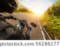 View from motorcycle driver perspective in sunset 56286277