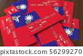 Pile of credit cards with flag of Taiwan. Taiwanese banking system conceptual 3D rendering 56299270
