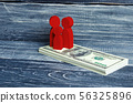 Red people and a child are standing on money 56325896