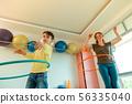 Nice joyful woman showing how to rotate hula hoop 56335040