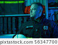 Image of fireman looking to side , neon effect 56347700
