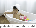 Asian Baby Sitting on bathtub 56356561