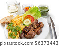 Dish for lunch of fried pork ribs, potatoes and salad. Portuguese dish. 56373443