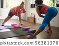 Fat women in color tracksuits stretching in gym 56381378