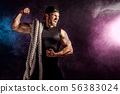 Men holding battle rope, functional training 56383024