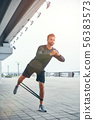 You can do more Full-length of young and confident bearded man in sportswear doing exercises while 56383573