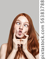 Crazy girl Close up photo of happy young redhead woman making crazy face and grimacing while 56383788