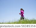 Woman running empty 56385356