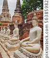 Buddhist statue in front of ancient Thai temple Ay 56385982