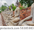 Buddhist statue in front of ancient Thai temple Ay 56385983