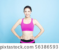 smiling young Fitness woman portrait isolated 56386593