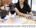 Photo artist and graphic desginer selecting 56419592