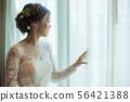 Asian bride standing near window in dressing 56421388
