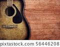 Guitar on wooden background vintage 56446208