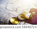 Golden compass, gold pocket watch and passport on 56446723