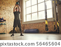 Making perfect body. Full-length of strong and handsome man holding big black dumbbell under his 56465604