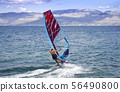 Young windsurfer in the waves in the sea 56490800