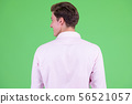Rear view of young handsome businessman looking over shoulder 56521057
