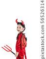girl in a halloween fancy dress devil 56526314