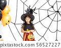 Happy Halloween little witch with a pumpkin 56527227