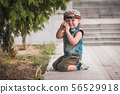Cute little boy at summer day playing and smiling  56529918