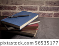 stack of books next to a pen 56535177