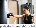 Asian woman training boxing at gym 56535946