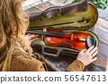 Womans hands with violin and case for violin 56547613