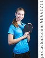 Portrait Of Young woman Playing Tennis On Black 56551711