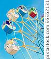 Ferris wheel carousel against of the sky. 56562131