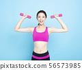Happy asian fitness woman lifting dumbbells 56573985
