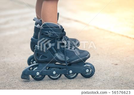 Closeup inline rollerblade on the legs 56576623