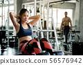 Asian women wearing blue tightening exercises 56576942