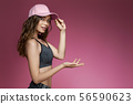 slim woman in shorts and a pink cap 56590623